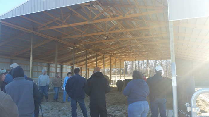 Tour attendees discussing new cow/calf feeding facility with owners, Perry County District Technician and NRCS Engineer.